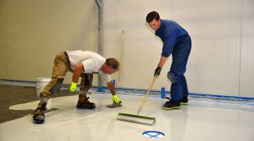 Contractors installing epoxy flooring
