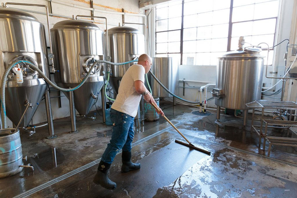 Brewery flooring being swept of spillages
